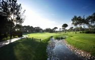Montgomerie Maxx Royal Golf Course, a stream bisects the fairway