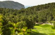 View Andratx Golf Course - Camp de Mar's picturesque golf course within dazzling Mallorca.