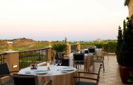 View Monte Rei Golf  Country Club's lovely restaurant terrace in astounding Algarve.