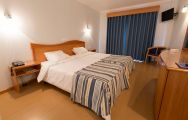 View Hotel do Mar's beautiful double bedroom within fantastic Lisbon.