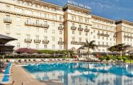 View Palacio Estoril Hotel's picturesque outdoor pool situated in fantastic Lisbon.