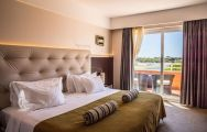 View Quinta da Marinha Resort Hotel's scenic double bedroom in sensational Lisbon.