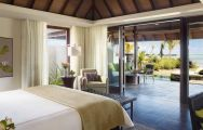 View Four Seasons Resort Mauritius at Anahita's beautiful double bedroom within stunning Mauritius.