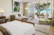 View Heritage Le Telfair Golf  Spa Resort's scenic sea view double bedroom in impressive Mauritius.
