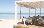View Heritage Le Telfair Golf  Spa Resort's scenic beachfront restaurant in vibrant Mauritius.