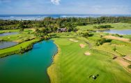 View The Heritage Golf Club's impressive 18th hole in impressive Mauritius.