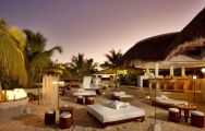 View Melia Caribe Tropical Golf  Beach Resort's lovely beach bar within striking Dominican Republic.