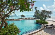 View Dusit Thani Hotel's picturesque main pool in pleasing Pattaya.