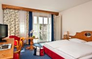 View Hotel Maximilian's comfortable double bedroom in pleasing Germany.