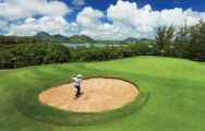 The Ile aux Cerfs Le Touessrok's picturesque golf course within stunning Mauritius.