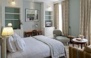 The Vidago Palace Hotel's picturesque double bedroom within stunning Porto.