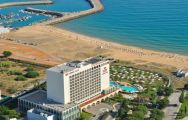 the crowne plaza hotel viewed from the air, with the vilamoura beach in the background