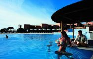 drinking at the pool bar of the vila sol golf resort and spa hotel