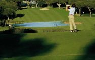 a golfer teeing off at the vila sol golf course