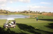 a buggy standing on the fairway at silves golf course