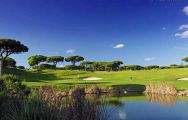 a view across the water to the 14th green at vale do lobo oceanroyal