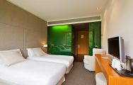 View DoubleTree by Hilton La Mola Hotel's picturesque twin room within dazzling Costa Brava.