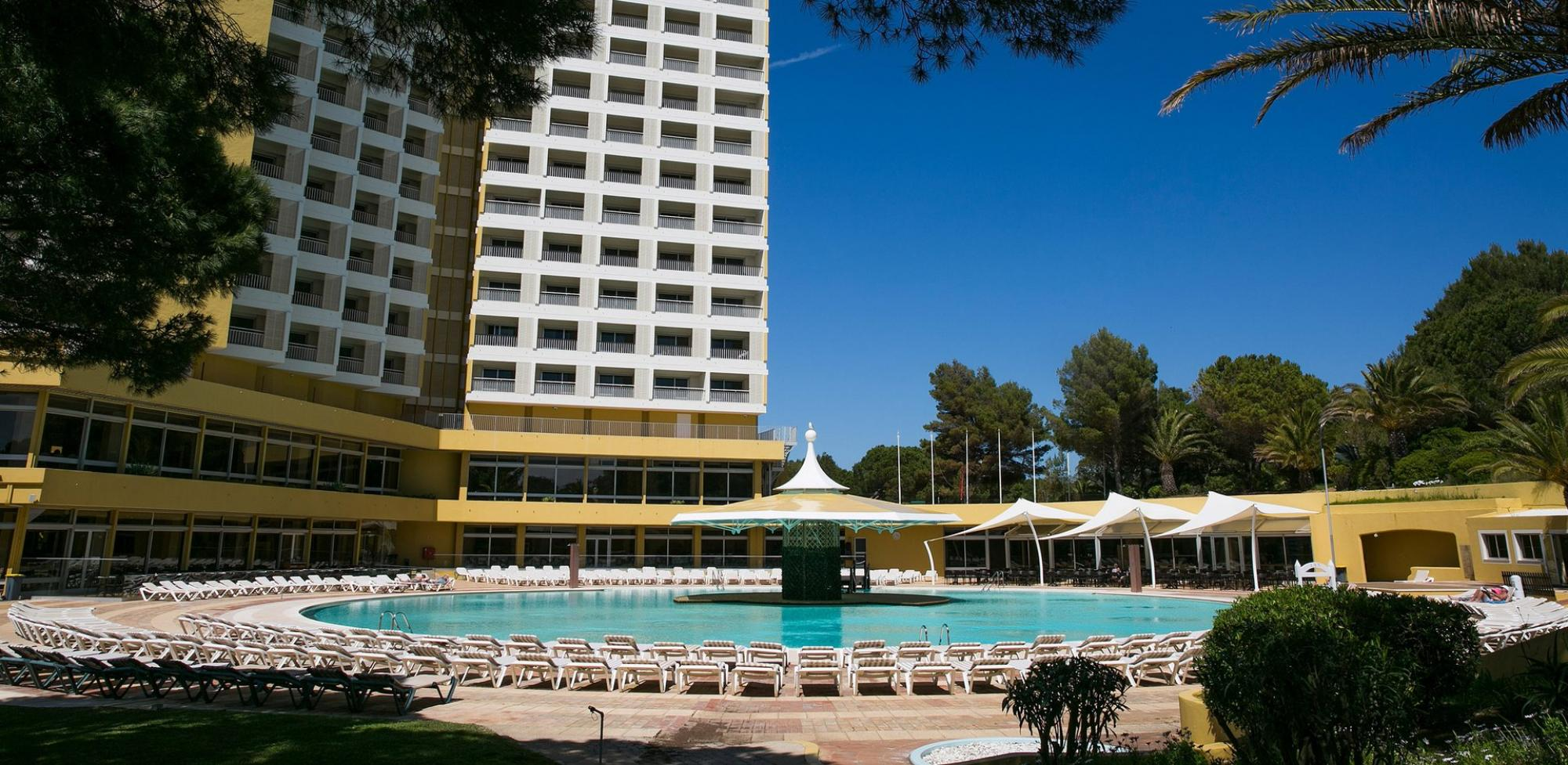 The Pestana Delfim Hotel's impressive outdoor pool situated in vibrant Algarve.