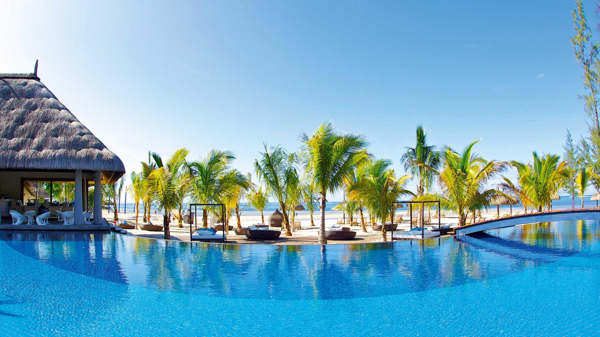 The Heritage Le Telfair Golf  Spa Resort's picturesque main pool situated in impressive Mauritius.