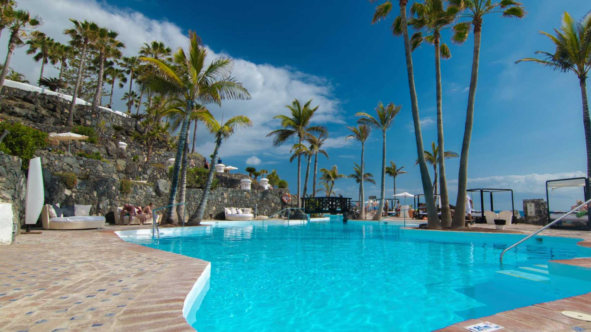 View Hotel Jardin Tropical's lovely main pool situated in brilliant Tenerife.