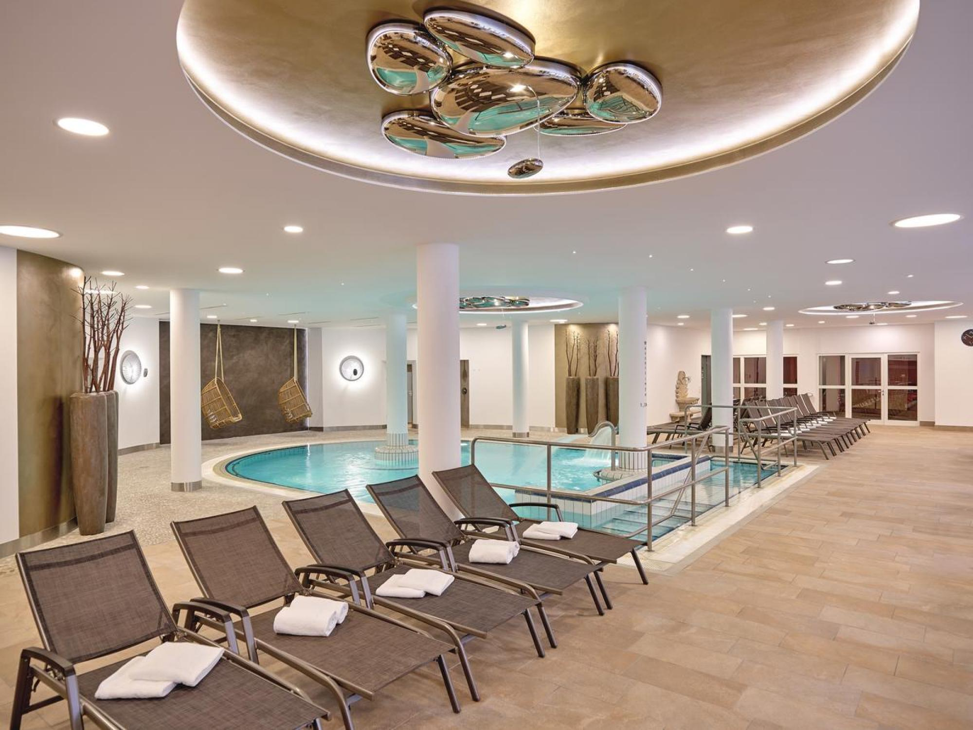 View Hotel Maximilian's picturesque indoor pool within amazing Germany.