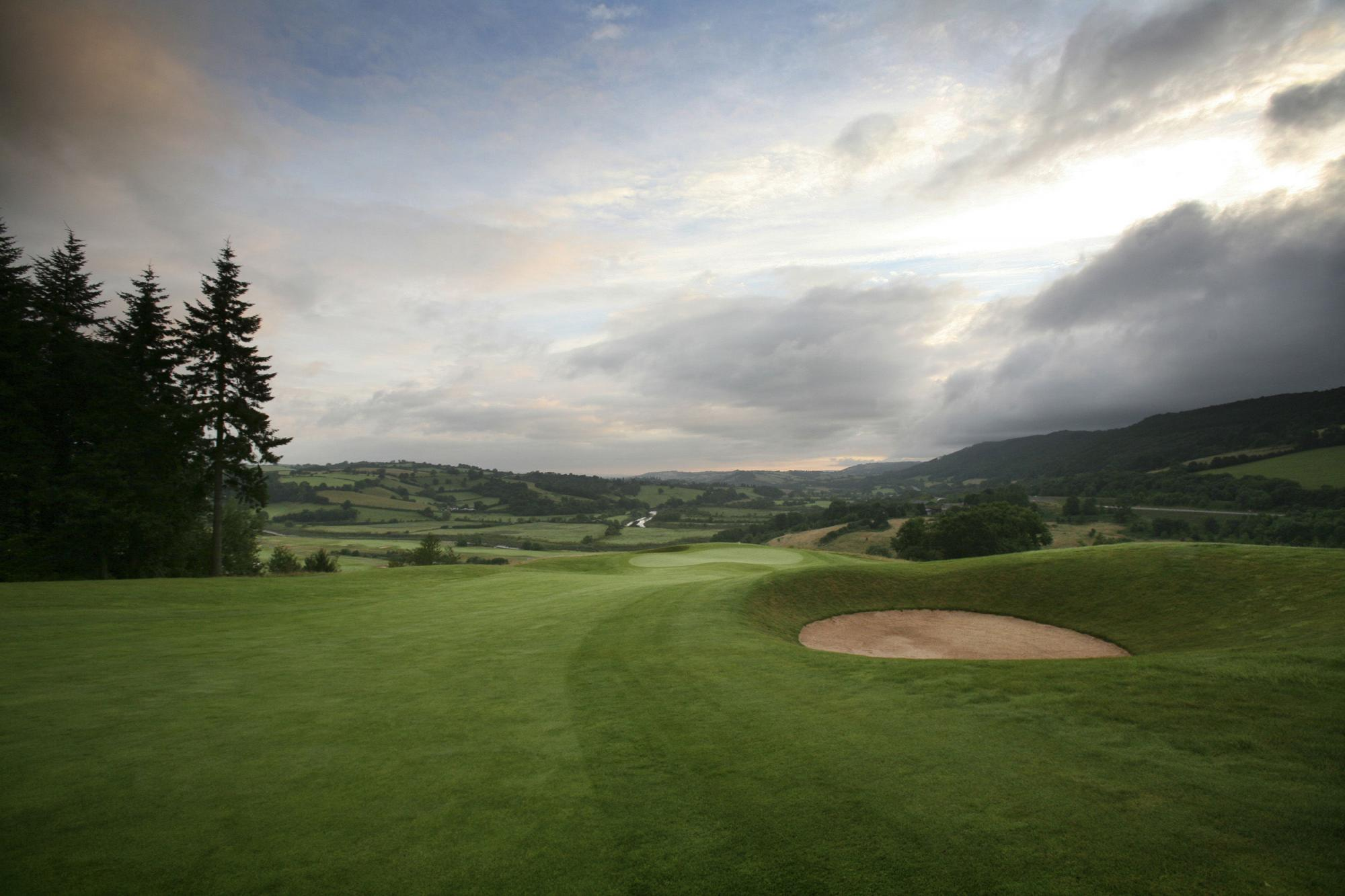 View The Montgomerie Course at Celtic Manor Resort's picturesque golf course within dazzling Wales.