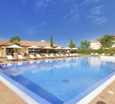 The Monte Rei Golf  Country Club's impressive outdoor pool situated in breathtaking Algarve.