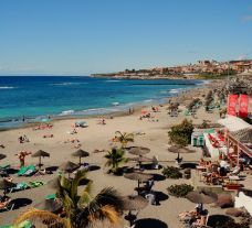 The Cleopatra Palace Hotel's impressive Playa de Las Americas beach situated in vibrant Tenerife.