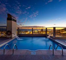 View Paradise Park Hotel's impressive rooftop pool situated in brilliant Tenerife.