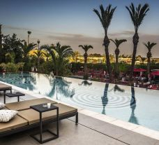 The Sofitel Marrakech Lounge  Spa Hotel's beautiful outdoor pool situated in marvelous Morocco.