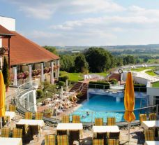 View Hotel Maximilian's picturesque outdoor pool within amazing Bavaria.