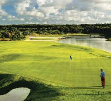 View Hard Rock Golf Club at Cana Bay's picturesque golf course within vibrant Dominican Republic.