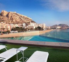 a view of the beach from the swimming pool of the Melia Alicante
