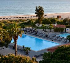 View Pestana Dom Joao II Hotel's picturesque outdoor pool within vibrant Algarve.