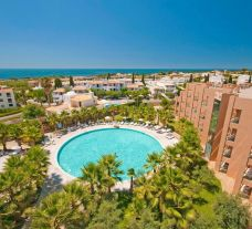 View Sao Rafael Suites Hotel's picturesque main pool within striking Algarve.