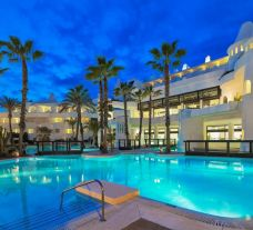 The H10 Estepona Palace's scenic outdoor pool situated in marvelous Costa Del Sol.