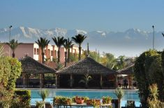 The Kenzi Menara Palace's picturesque poolside seating in incredible Morocco.
