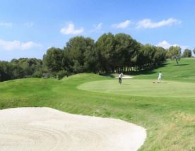 putting on the 14th green at Costa Dorada Golf Club