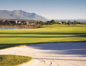 The Arabella Golf Club's picturesque golf course situated in impressive South Africa.