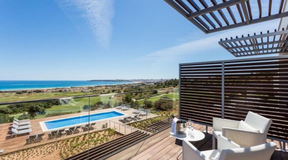 Onyria Palmares Beach House Hotel's picturesque balcony view within vibrant Algarve.