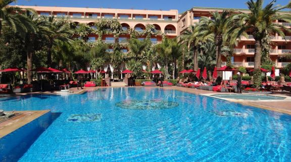 View Sofitel Marrakech Lounge  Spa Hotel's picturesque main pool within magnificent Morocco.