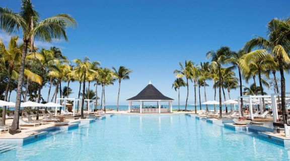 The Heritage Le Telfair Golf  Spa Resort's scenic main pool within dazzling Mauritius.