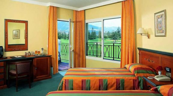 a twin bedroom at hotel tamisa golf