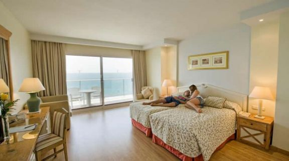 a twin bedroom at the THB Torrequebrada Hotel