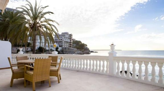 a terrace overlooking the sea at the Nixe Palace Hotel